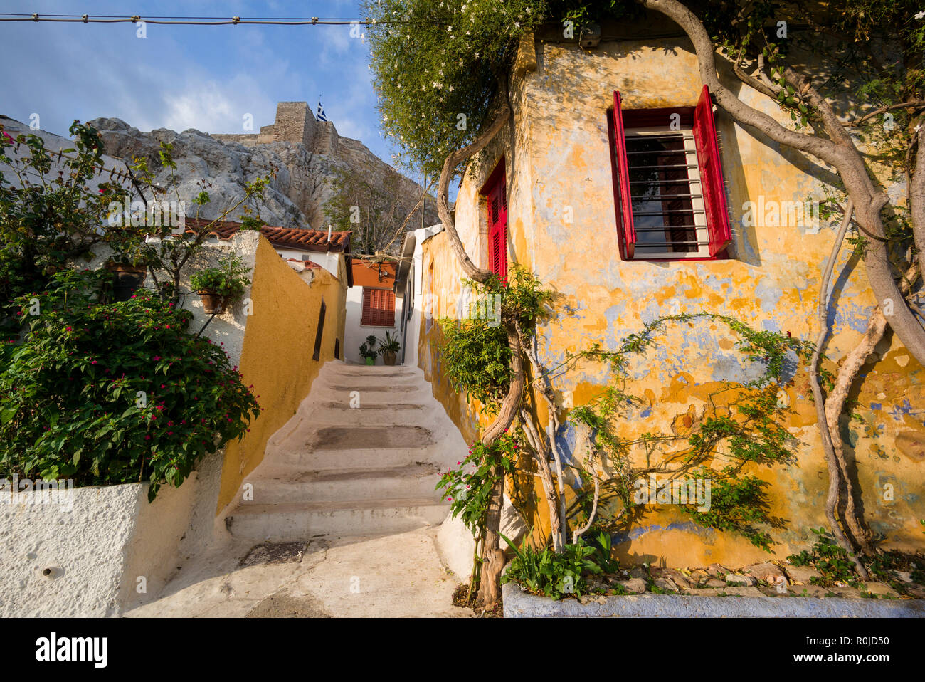 Athens. Greece. Cycladic style architecture of Anafiotika on the edge of the Plaka district nestles against the Acropolis. Stock Photo