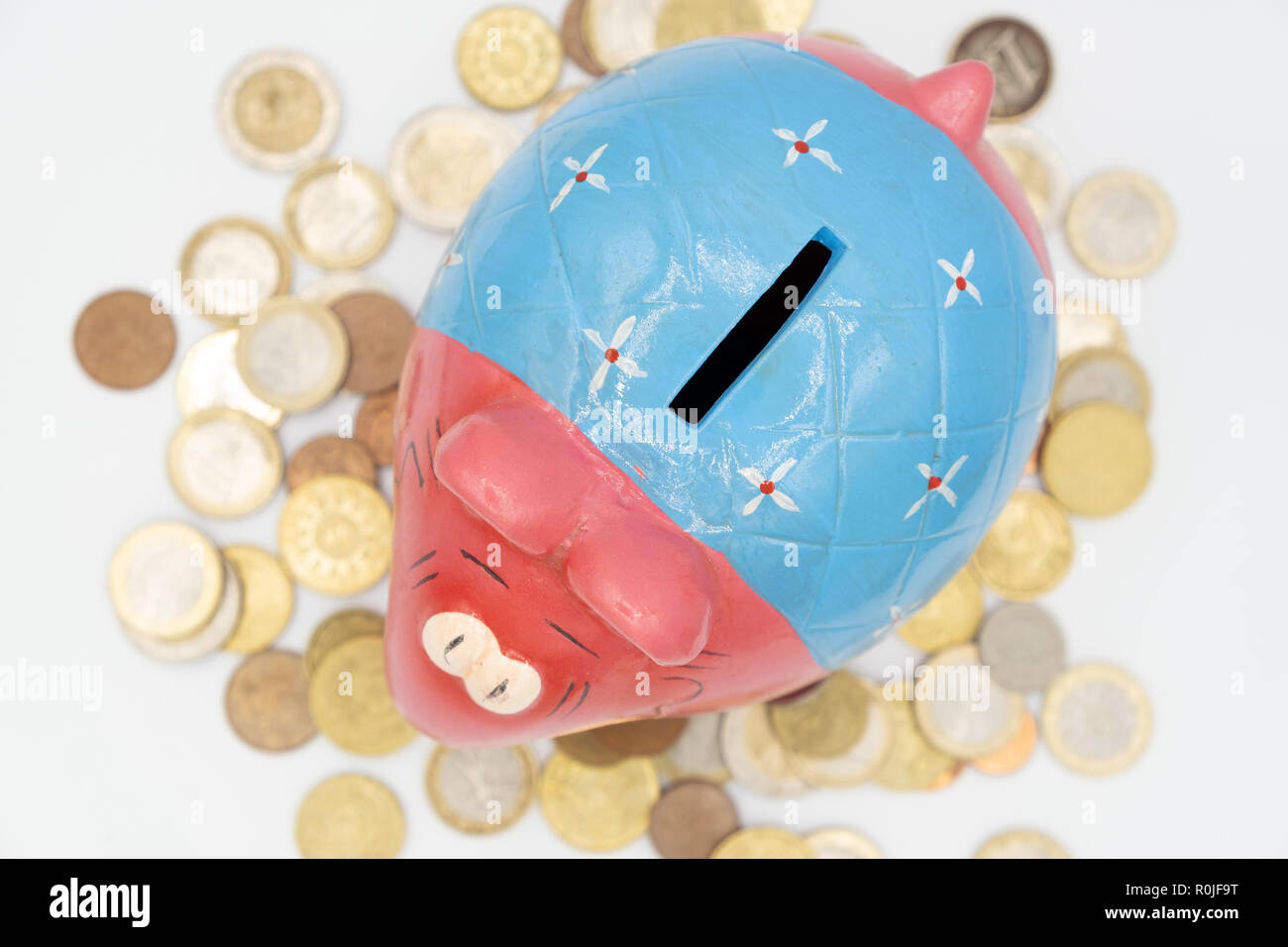 Colorful cute ceramic elephant piggy bank cut out isolated on white background Stock Photo