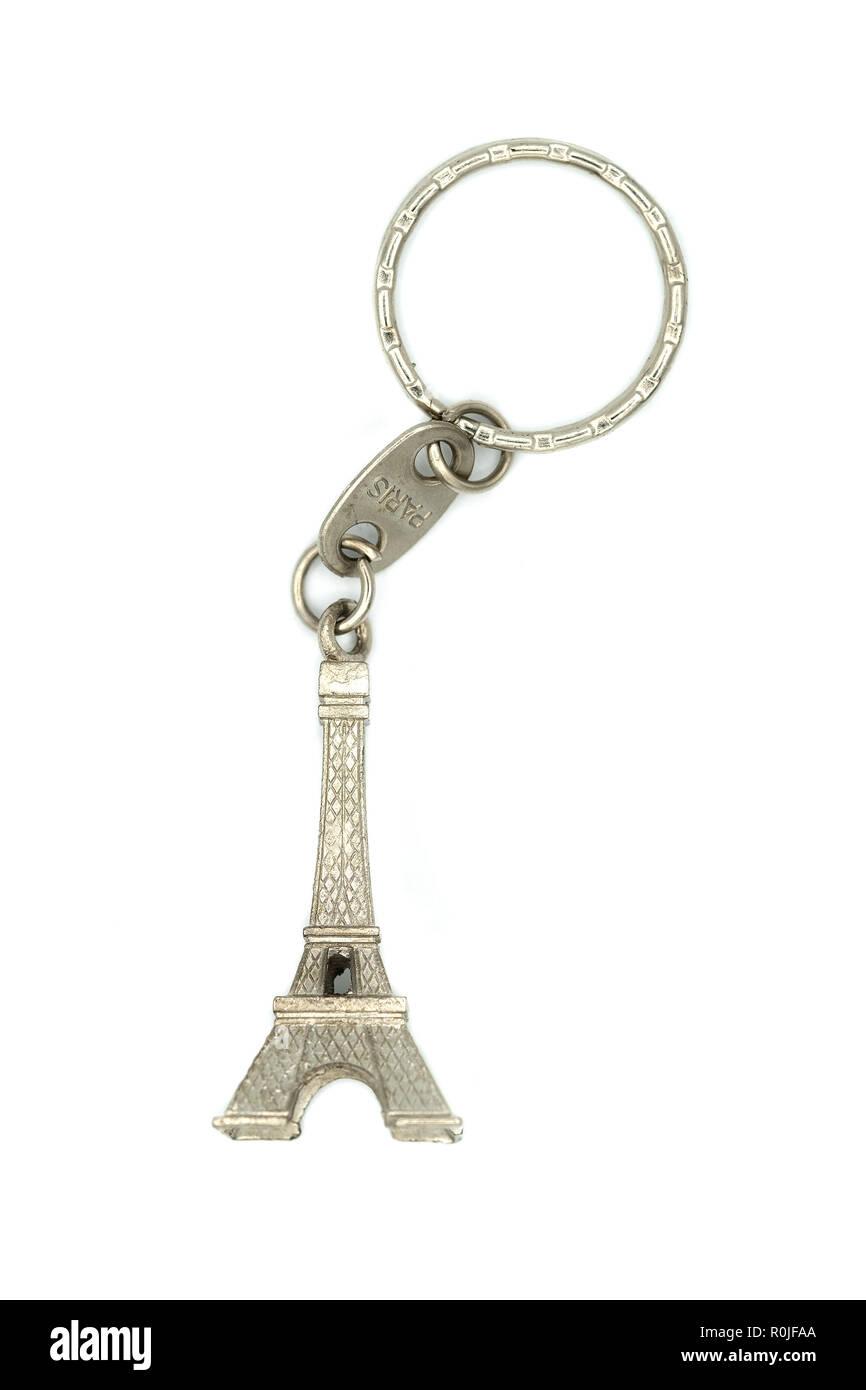 Miniature Eiffel Tower metallic key-chain Paris souvenir cut out isolated on white background - Stock Image