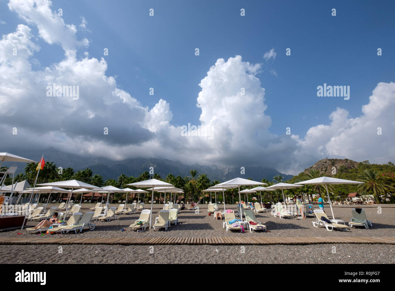 Deckchairs and beach umbrellas at the Club Med Palmiye luxury all inclusive resort, Kemer, Antalya, Turkey - Stock Image