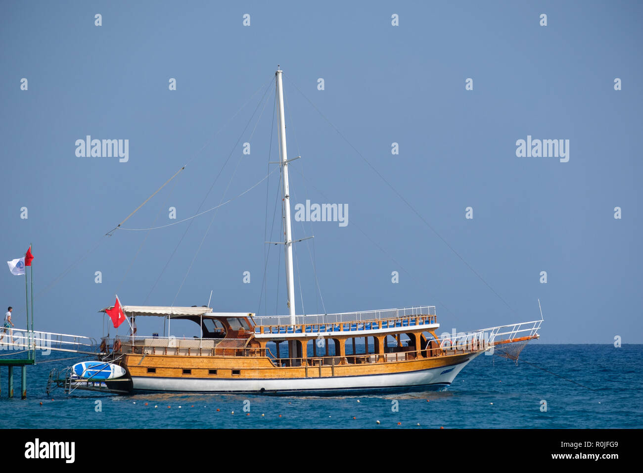 Boat used for snorkelling tours at the Club Med Palmiye luxury all inclusive resort, Kemer, Antalya, Turkey - Stock Image
