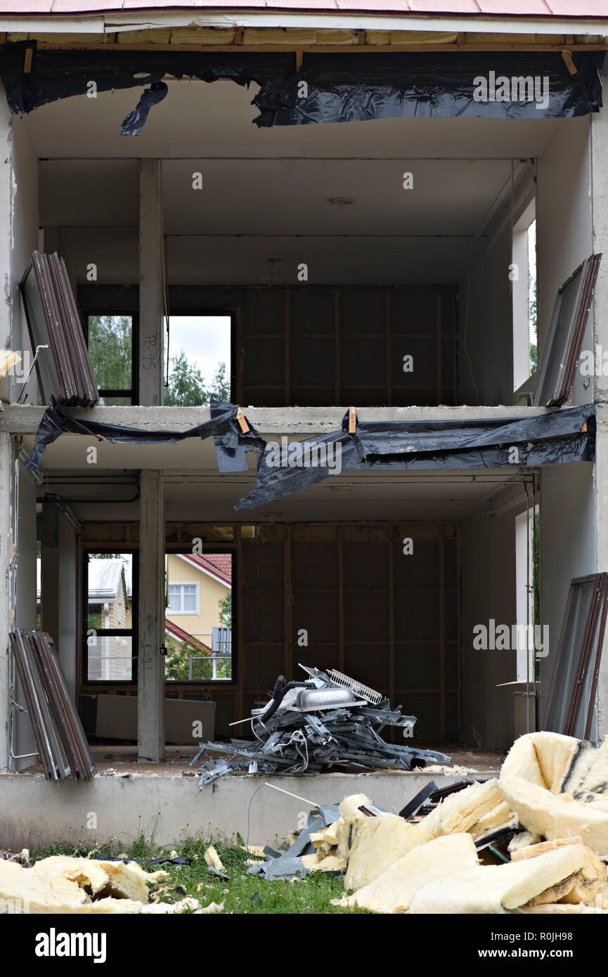 Debris in front of demolished house. - Stock Image