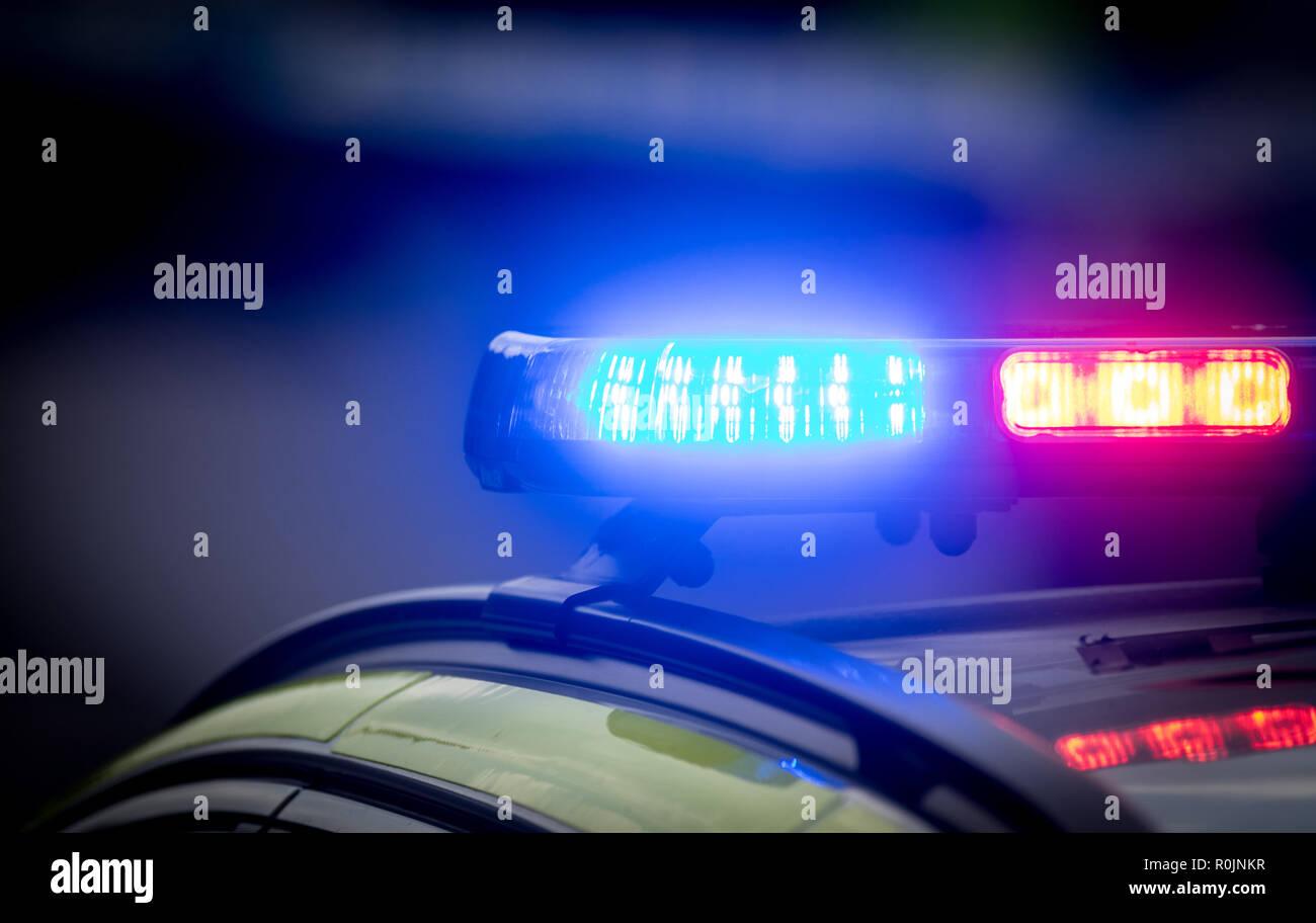 UK Police car lights flashing at a crime scene Stock Photo