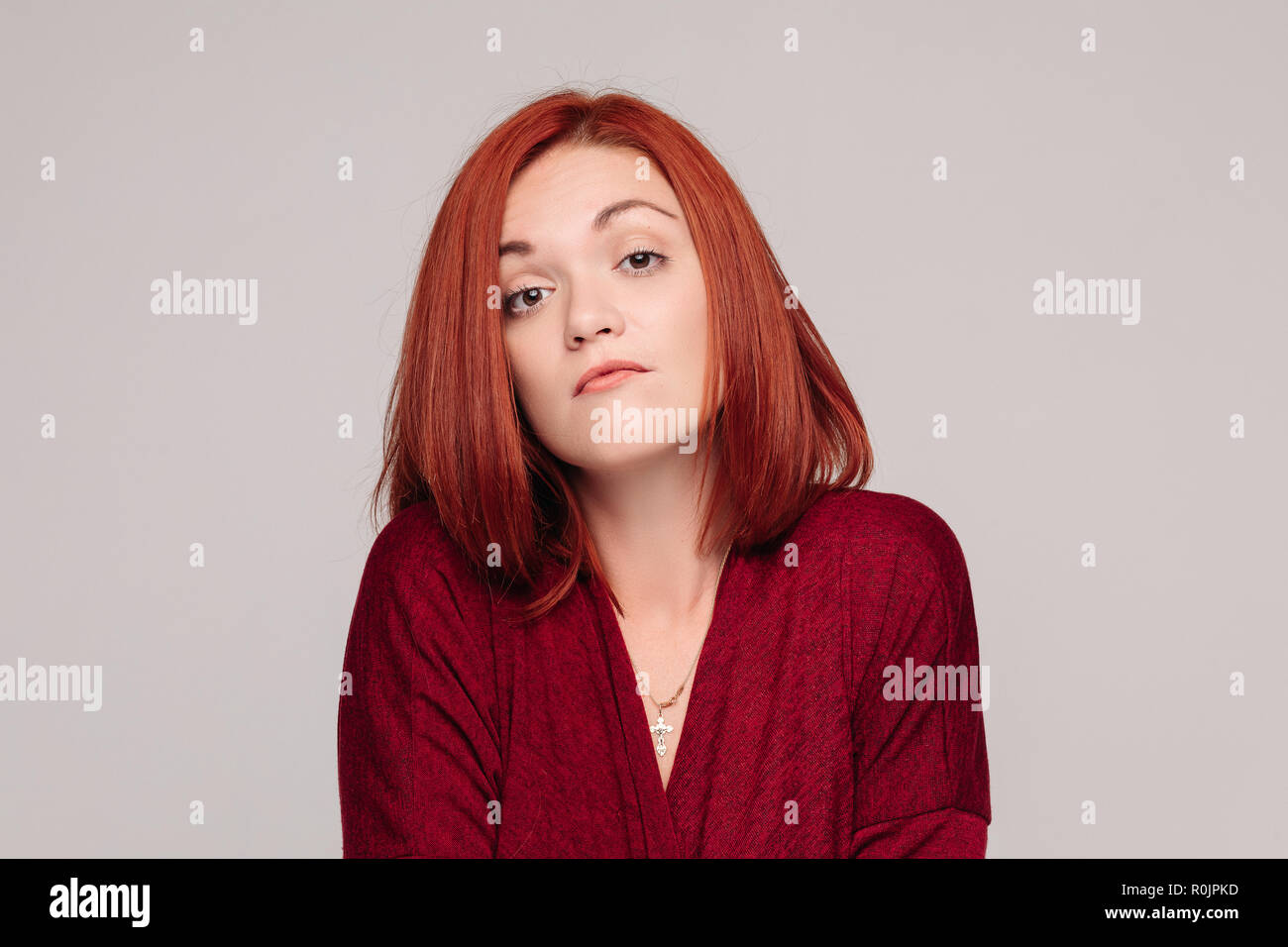 Business woman wearing in red having passive emotion and looking frustrated. - Stock Image