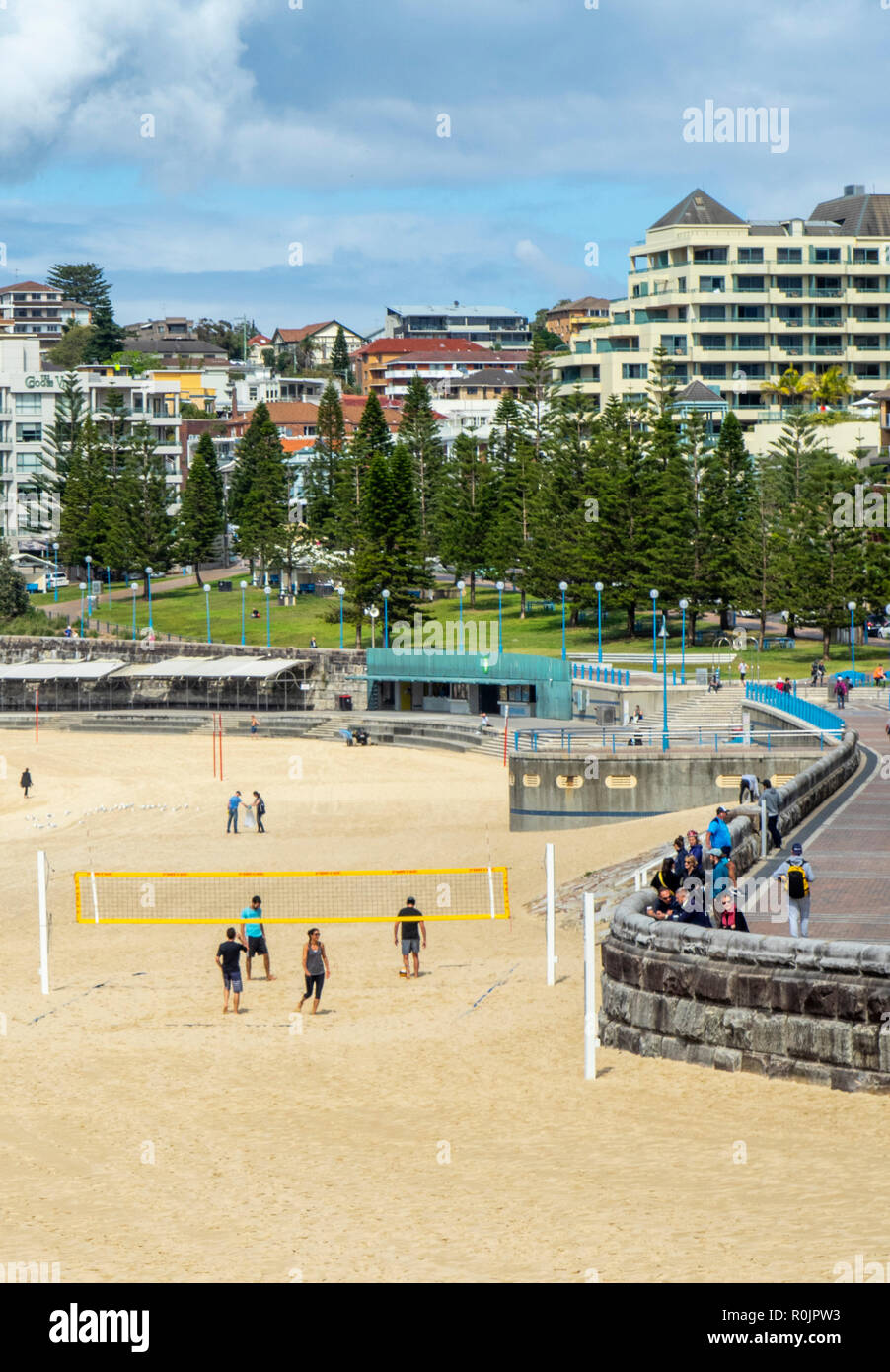 Four people playing beach volleyball at Coogee Beach  Sydney NSW Australia. - Stock Image