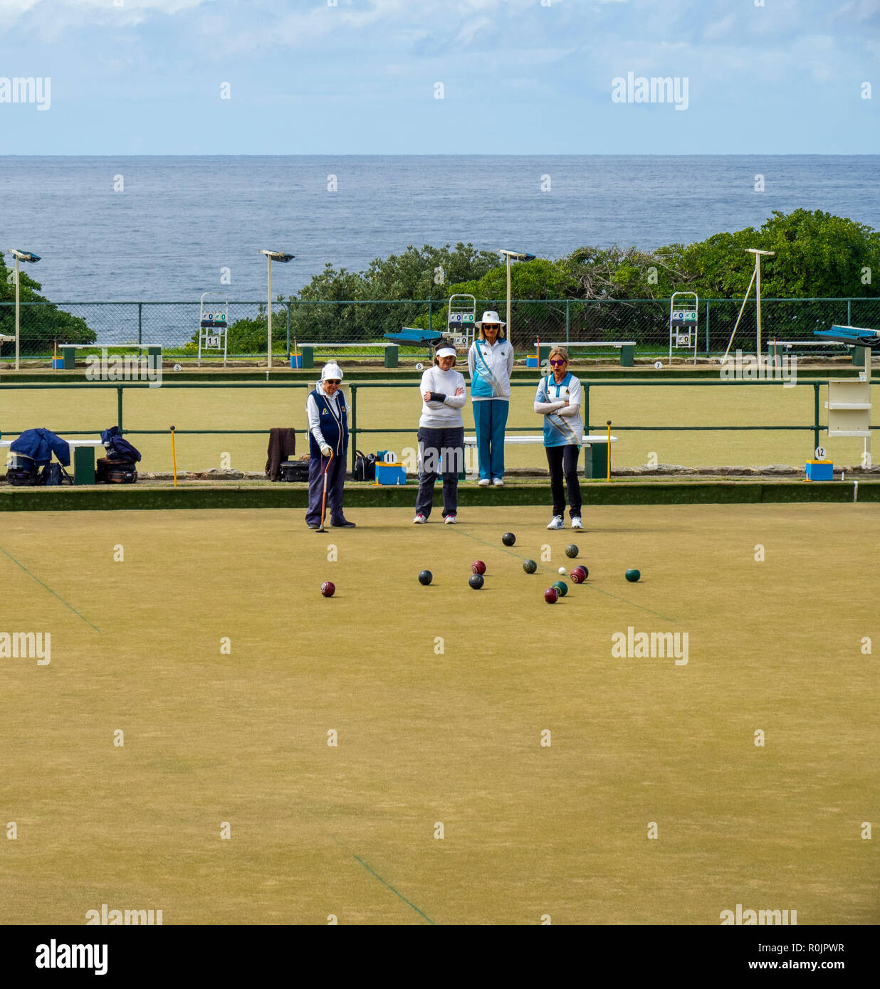 Four middle age to elderly women playing lawn bowls at Clovelly Bowling and Recreation Club Sydney NSW Australia. - Stock Image
