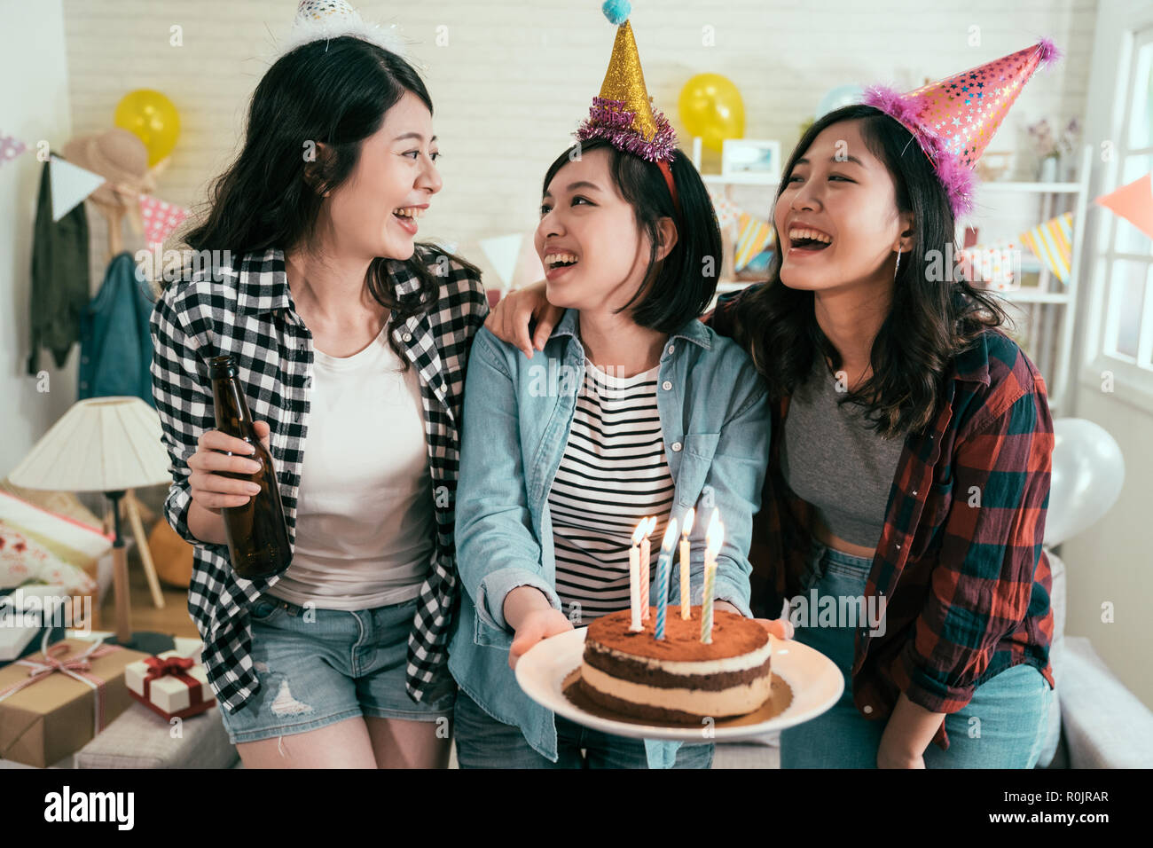 Girl Best Friends Birthday Party At Home Three Celebrating With Surprise In House Female People Holding Cake Candles On Fire S