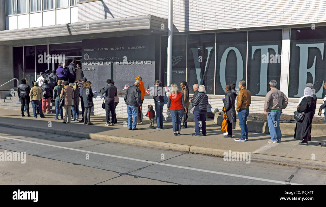 A diverse line of voters wait to cast their ballots for the 2018 Midterm Elections at the Cuyahoga County Board of Elections in Cleveland, Ohio, USA. - Stock Image