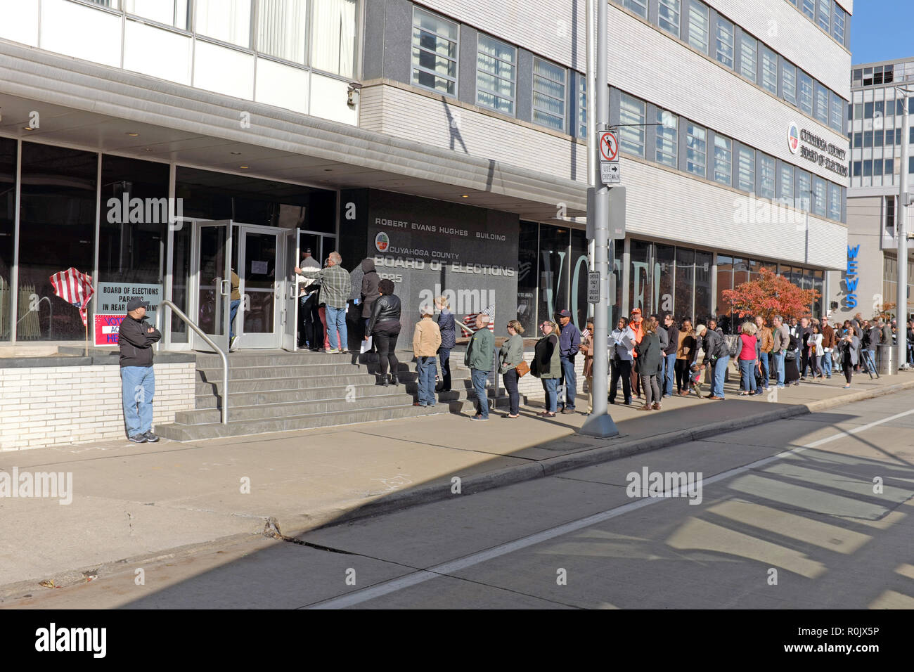 Voters wait in line at the downtown Cleveland Cuyahoga County Board of Elections to cast their votes during the 2018 Midterm Elections. - Stock Image