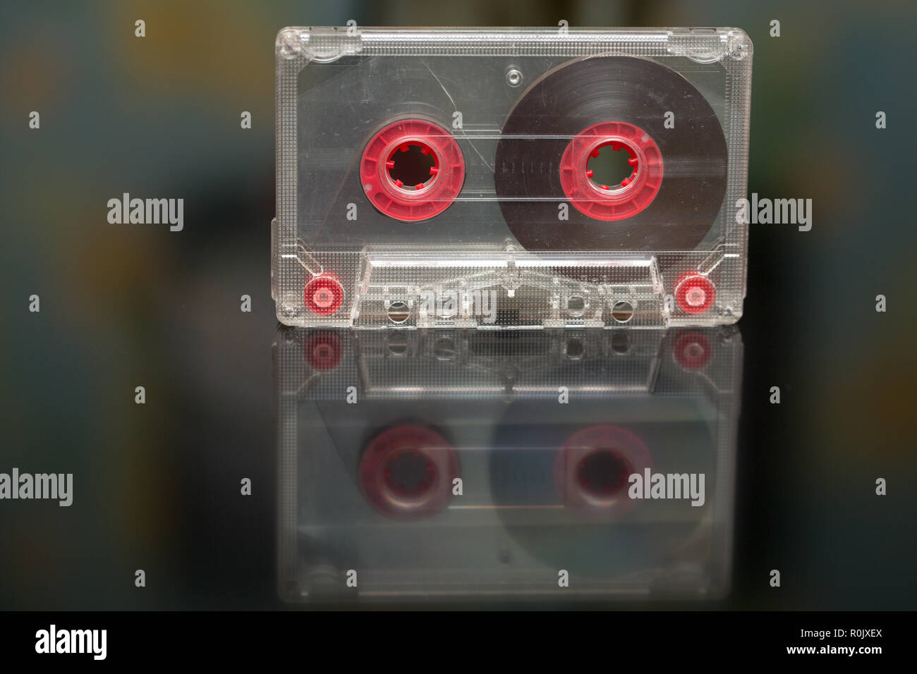 Old audio cassette on a black background, audio recording, film - Stock Image