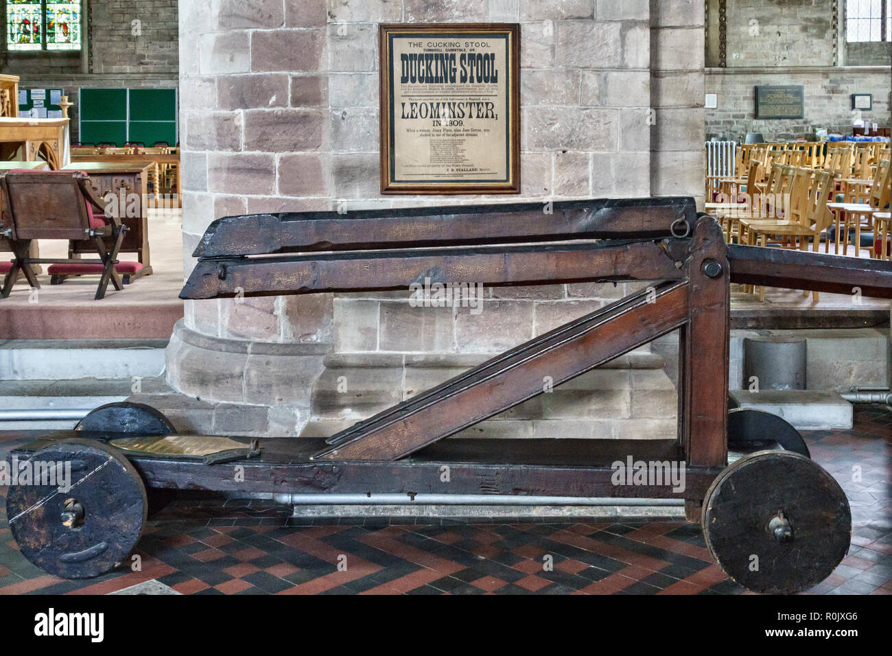 Herefordshire, UK. The old ducking stool (cucking stool) preserved in Leominster Priory Church. The last recorded use was in 1809 - Stock Image