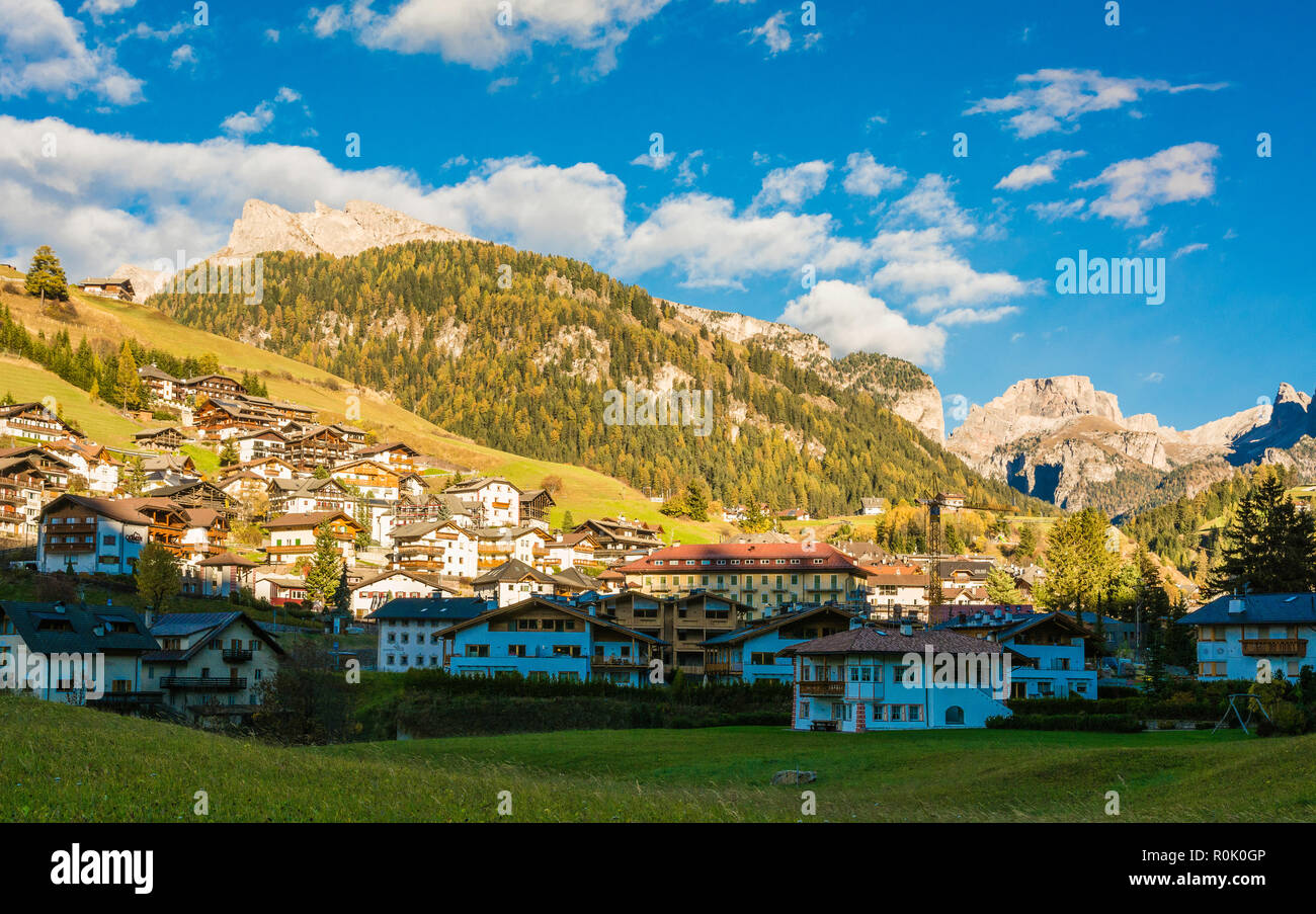autumn landscape in Gardena Valley. The town of Santa Cristina (St. Christina in Groden) with the light of the sunset, located in the heart of Dolomit Stock Photo