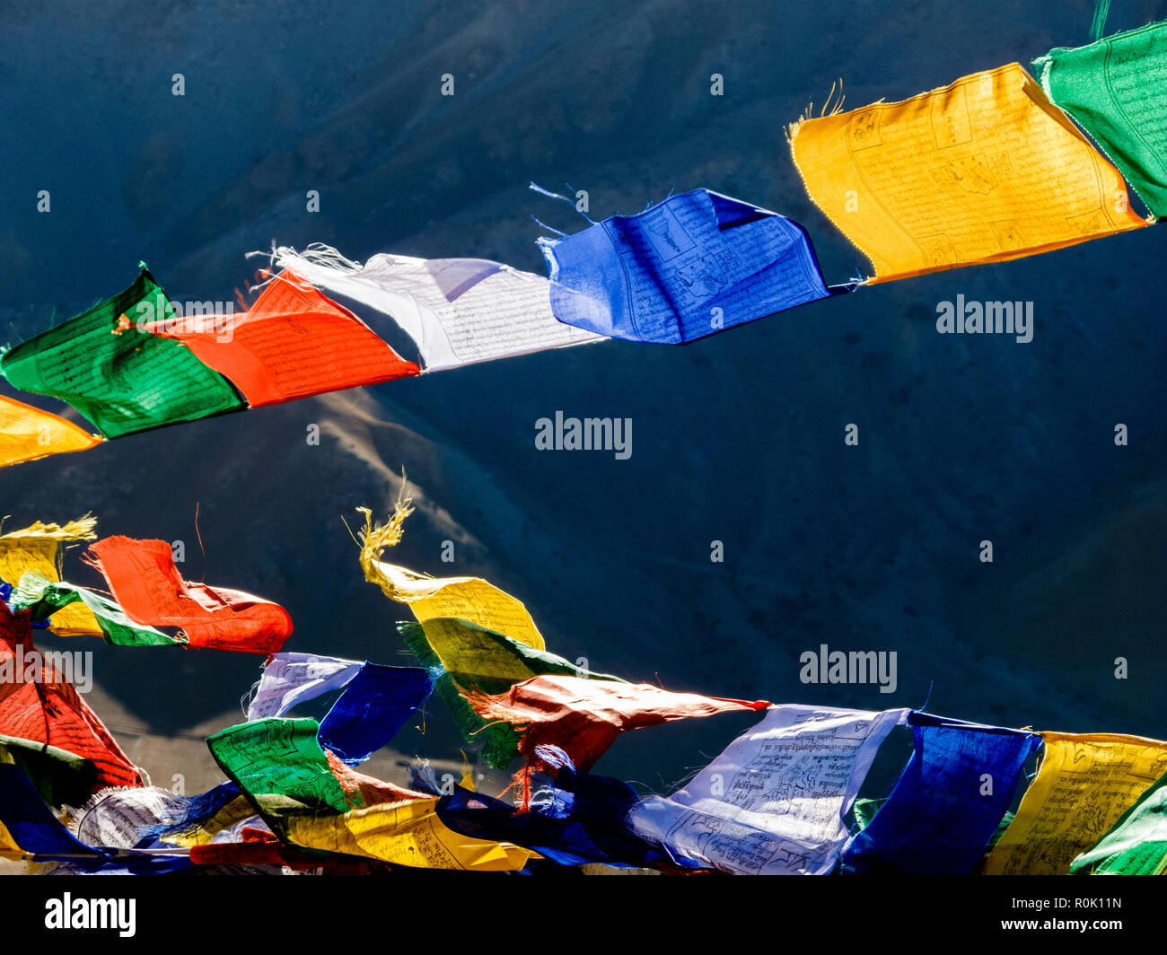 Prayerflags, wonderful buddhist tradition to spread good wishes for everyone - Stock Image