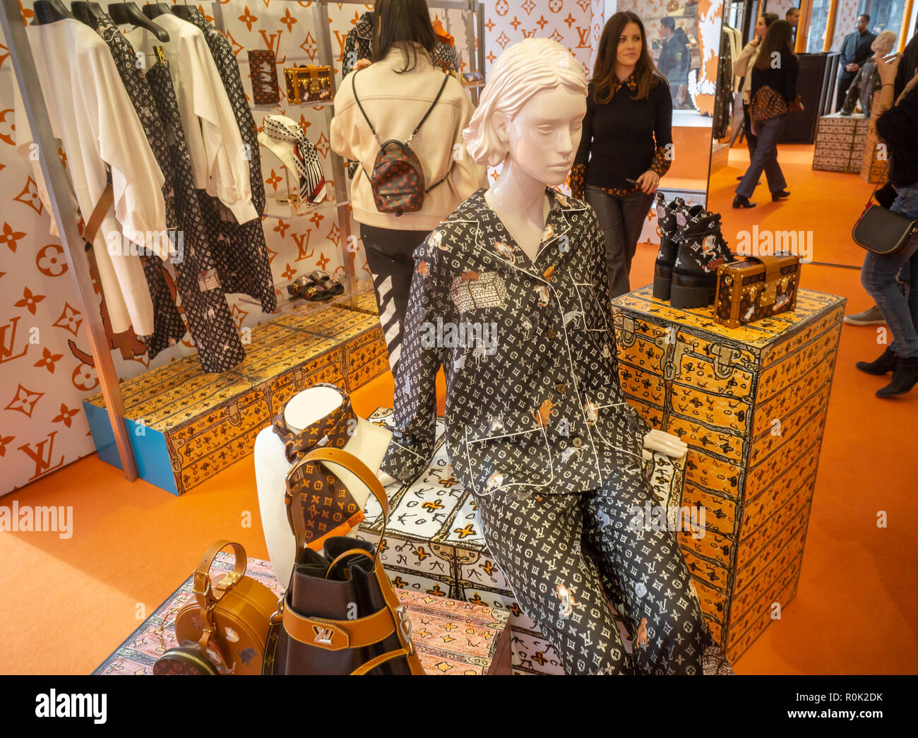 A cat-themed collaboration between he Louis Vuitton and fashion editor Grace Coddington opens a pop-up store in the trendy Meatpacking District in New York on Friday, October 26, 2018. Featuring Coddington's illustrations of her cats, the collection is named Catogram and the felines appear all over the leather goods, clothing shoes and even pajamas. (© Richard B. Levine) - Stock Image
