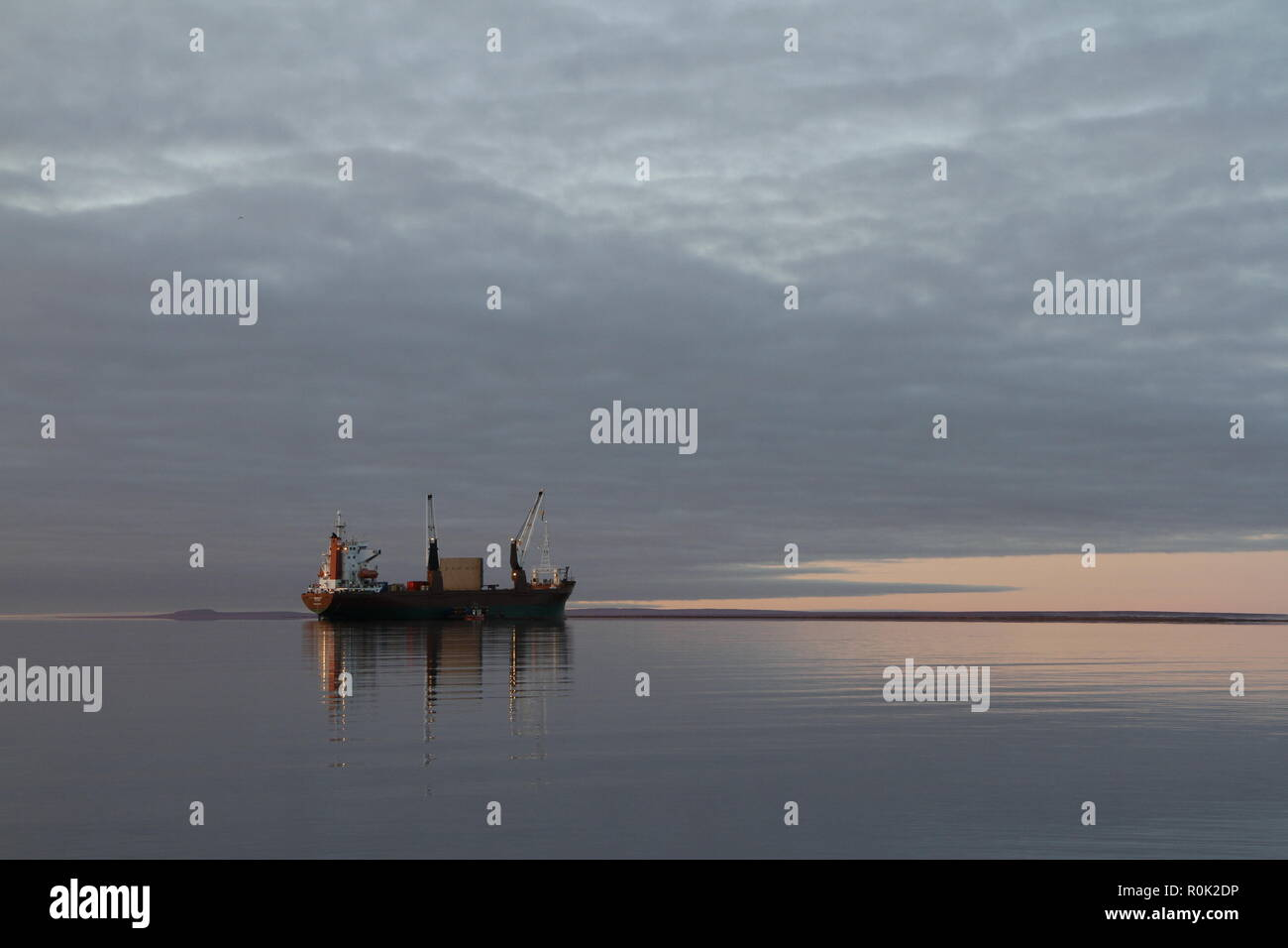 Resupply cargo barge on the waters of Nunavut near the community of Baker Lake in the Kivalliq Region - Stock Image