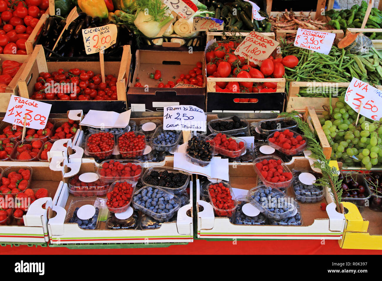 Big farmers market stall filled with organic fruits - Stock Image