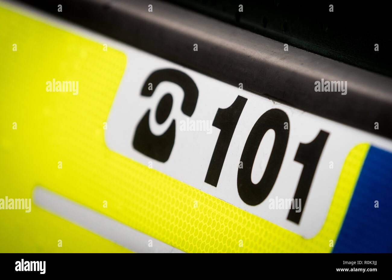 Police 101 non emergency phone number on the side of a police car Stock Photo