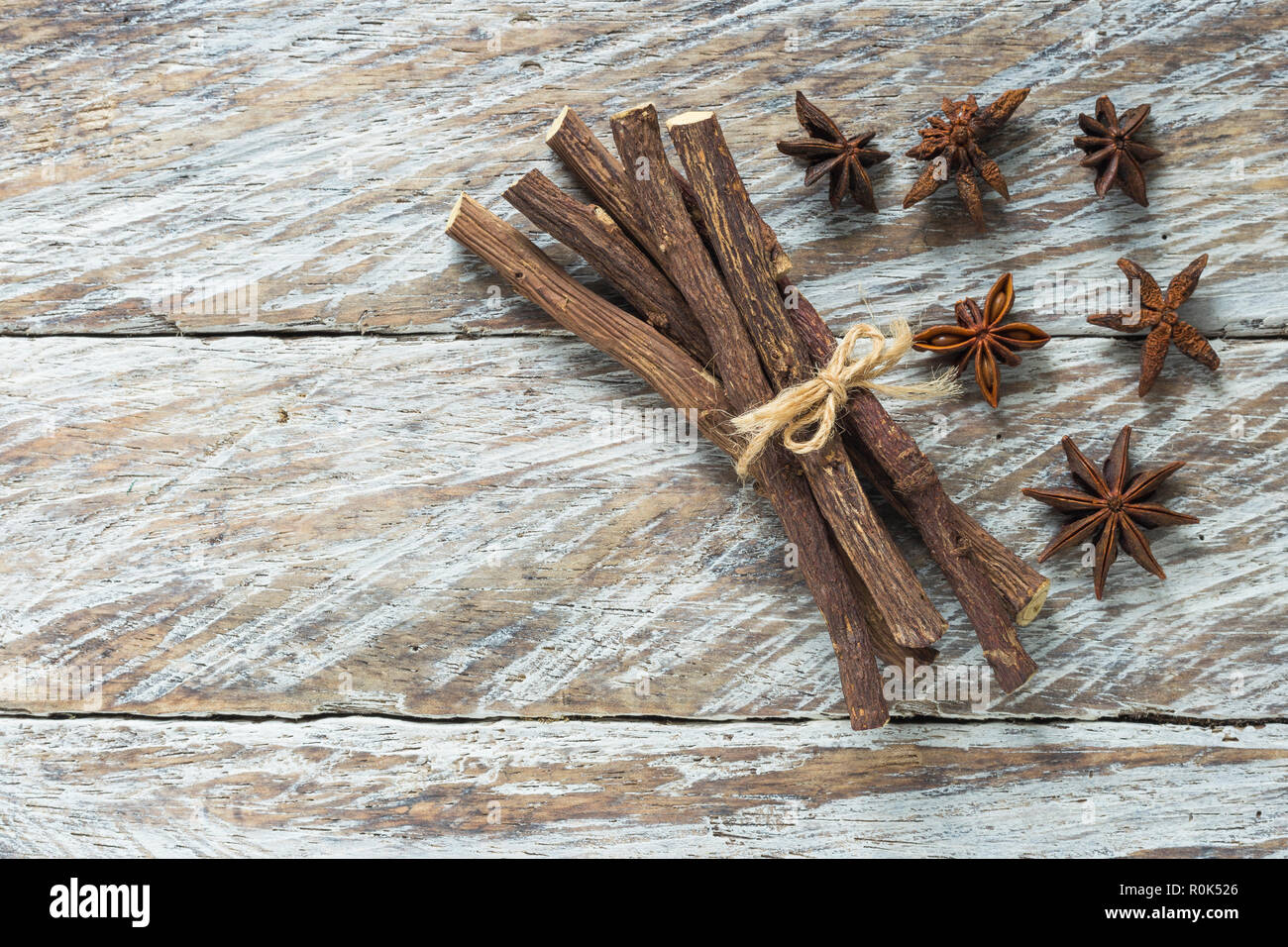 licorice root and anise on the table - Glycyrrhiza glabra. Stock Photo