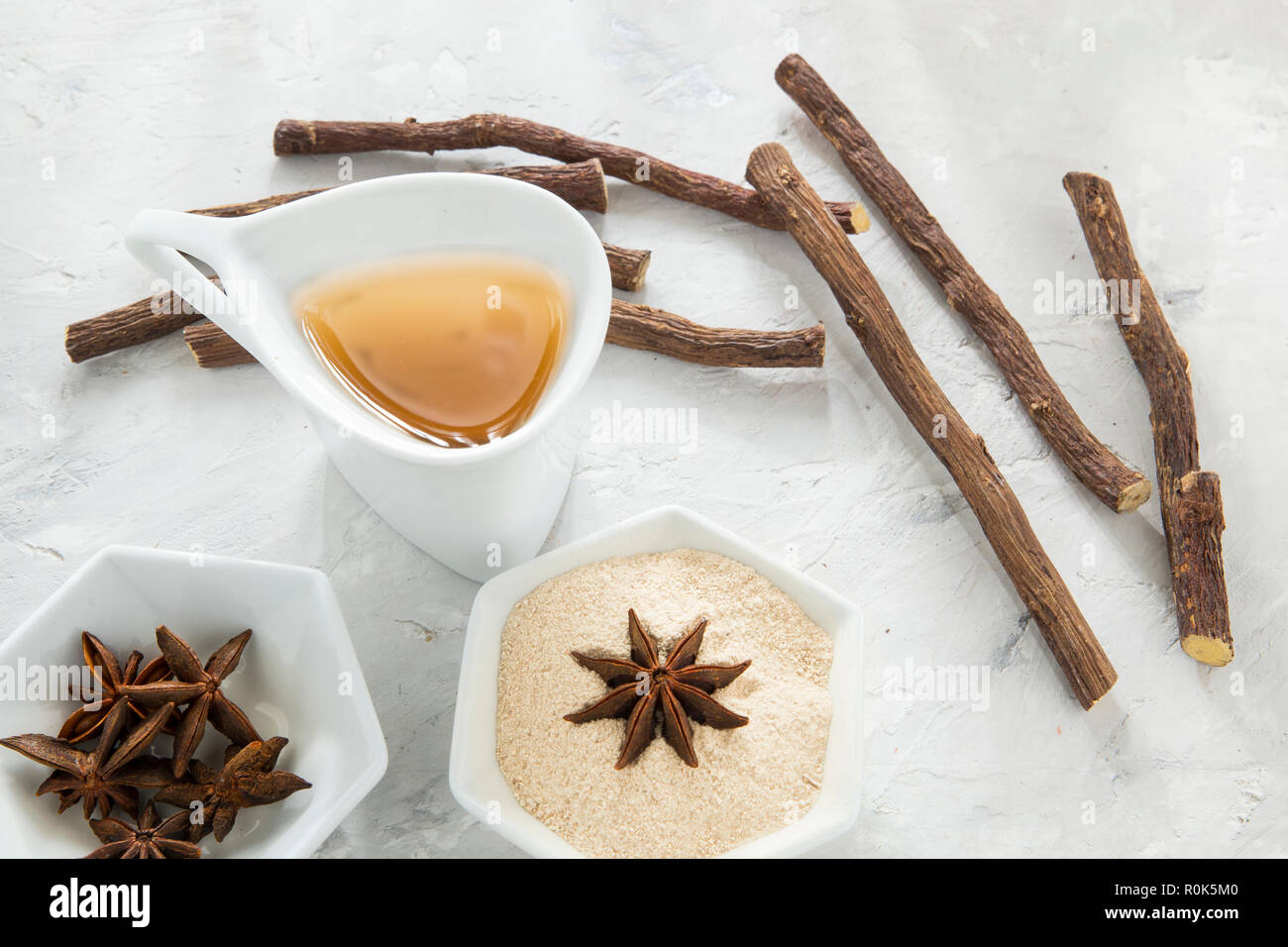 anise tea and liquorice roots on the table - Stock Image