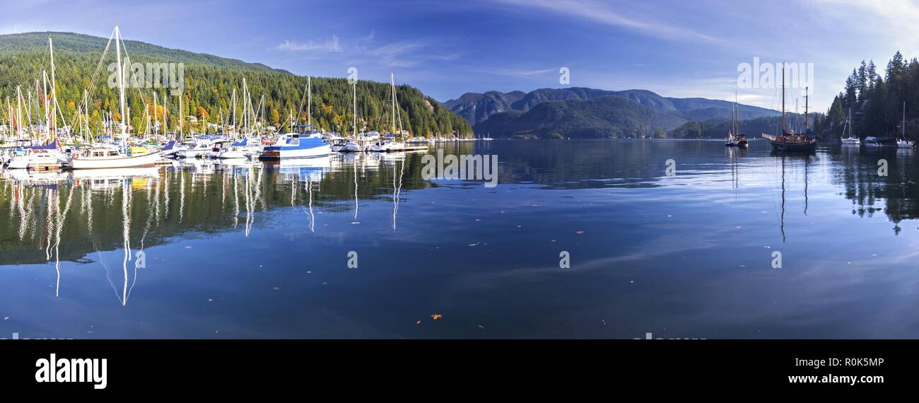 Wide Panoramic Scenic Landscape View of Indian Arm and Moored Yachts in Deep Cove Marina, Vancouver British Columbia Canada - Stock Image
