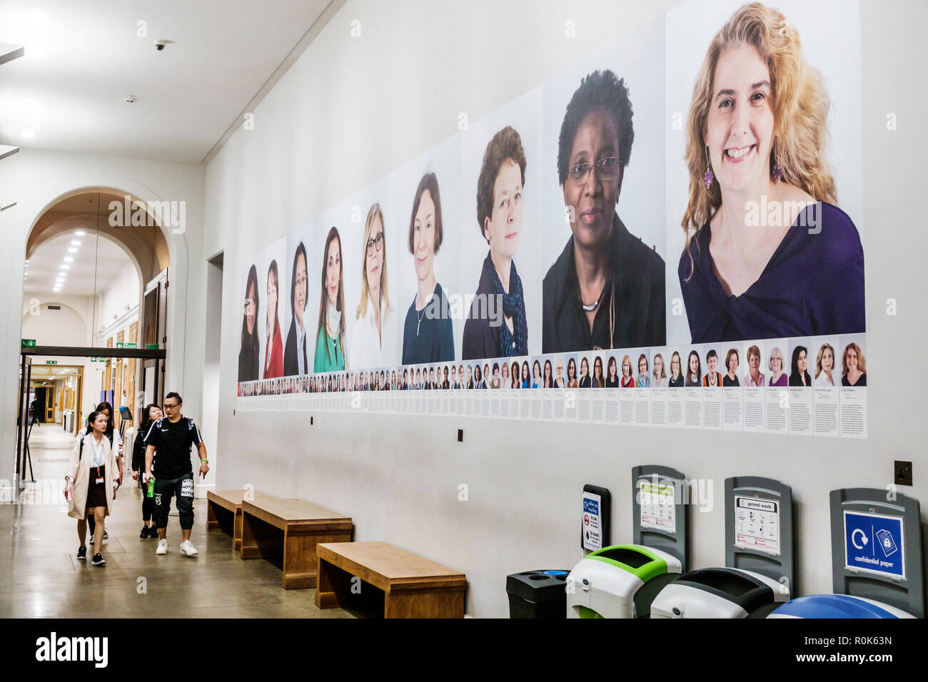 London England United Kingdom Great Britain Covent Garden Strand King's College King's Building campus public research university hallway posters wome - Stock Image