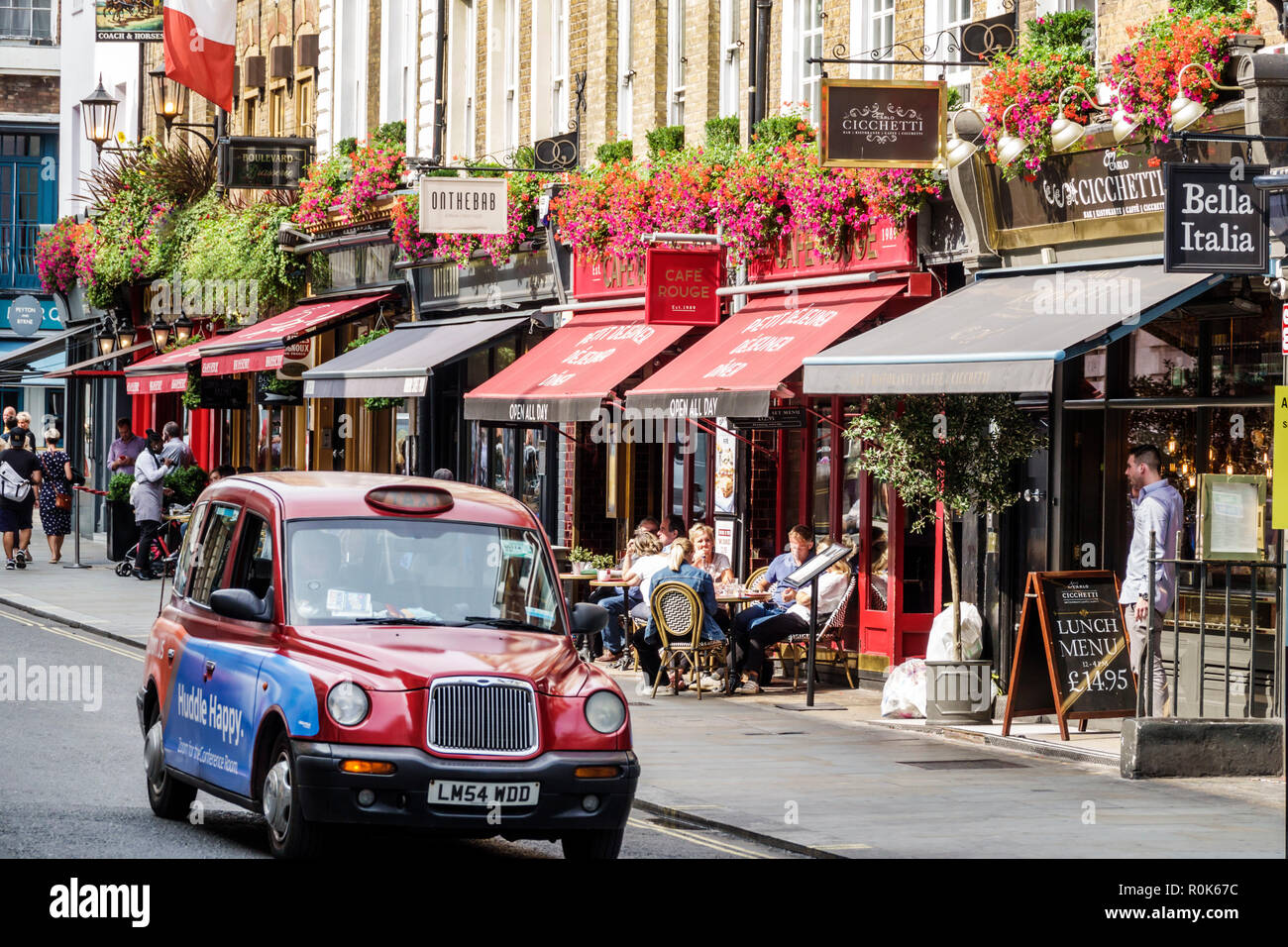 London England United Kingdom Great Britain Covent Garden Wellington Street shopping dining entertainment district restaurants sidewalk cafe awnings t - Stock Image
