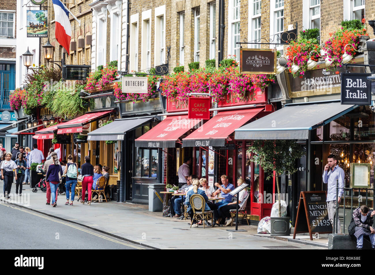 London England United Kingdom Great Britain Covent Garden Wellington Street shopping dining entertainment district restaurants sidewalk cafe awnings f - Stock Image