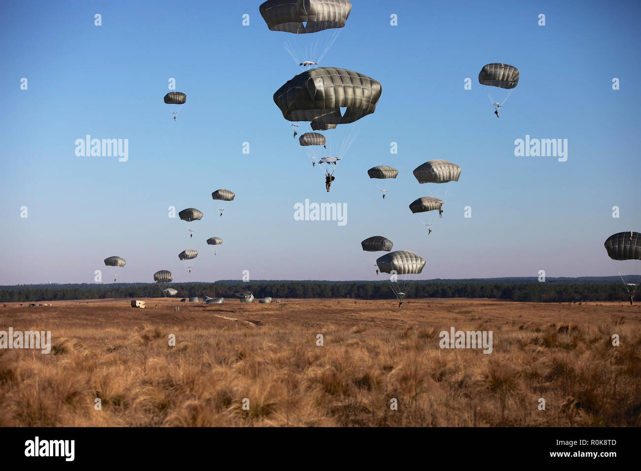 Paratroopers fill the sky for Operation Toy Drop at Fort Bragg, North Carolina. - Stock Image
