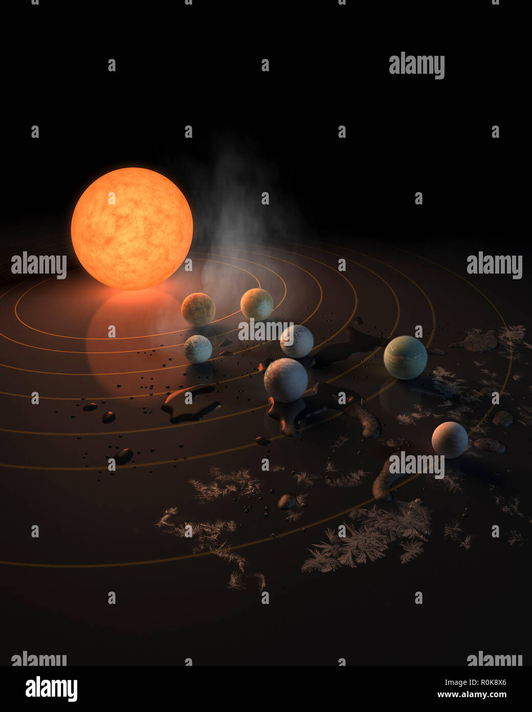 Artist concept of what TRAPPIST-1's seven planets might look like in orbit around their star. - Stock Image