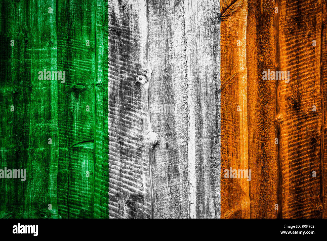 National flag of Ireland on textured wooden background, fence or wall - Stock Image