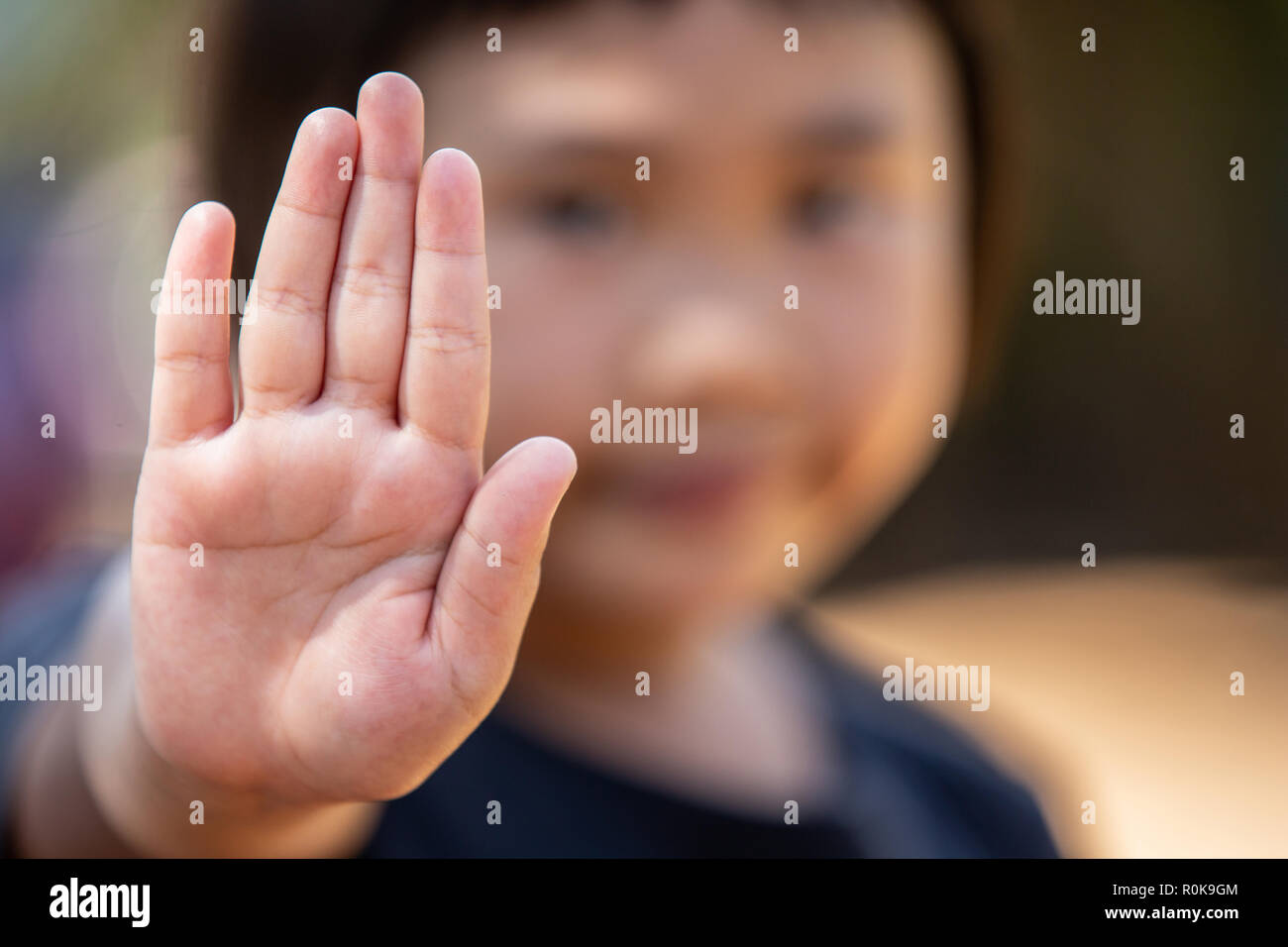 Stop harassment child and stop violence abuse in child. Hand stop no. Stock Photo