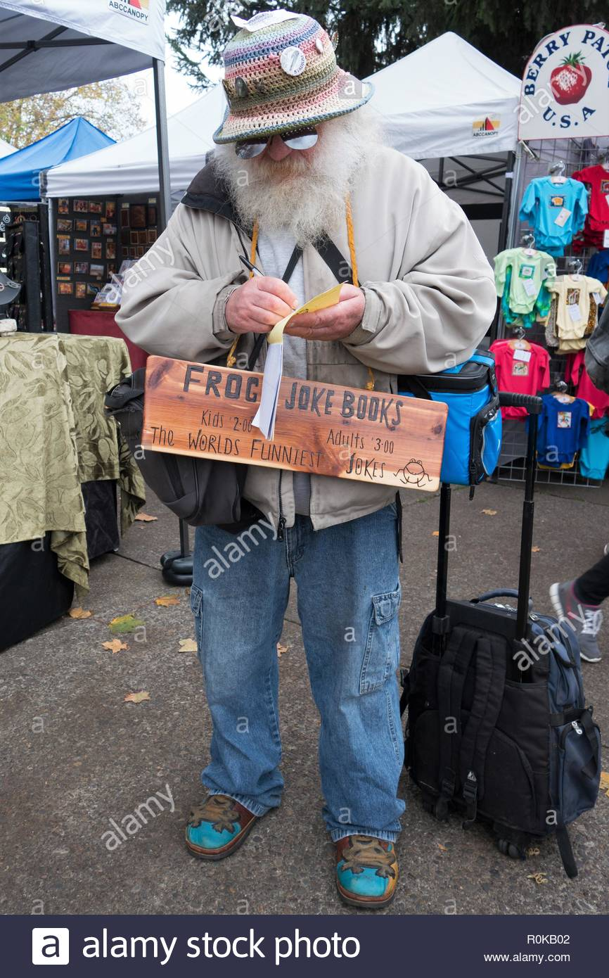 'Frog' Miller, a local icon in Eugene, OR, selling his recycled joke books on the streets of Eugene. - Stock Image