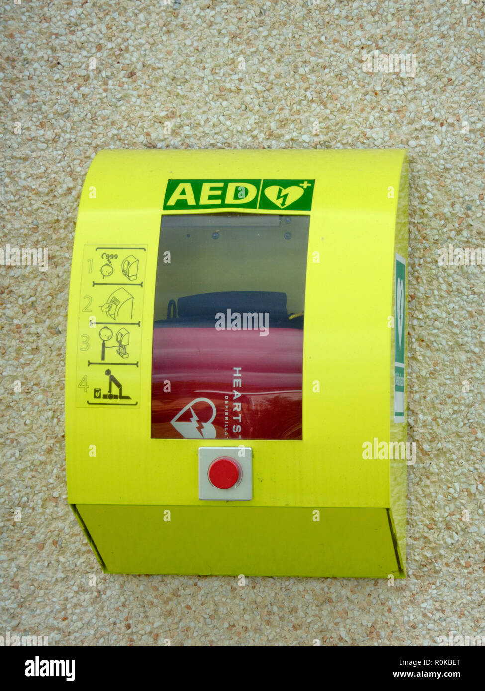 Defibrillator Medical Emergency Equipment Mounted on a n Outside Wall, UK - Stock Image