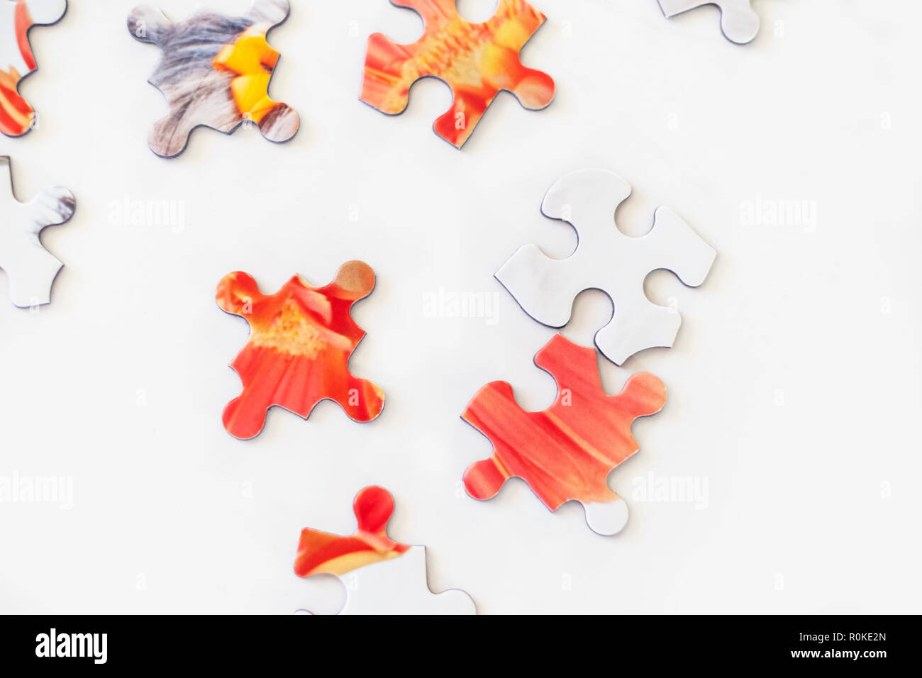 Puzzle pieces on white background. Representing solving problems, challenge, challenges, figuring out. - Stock Image