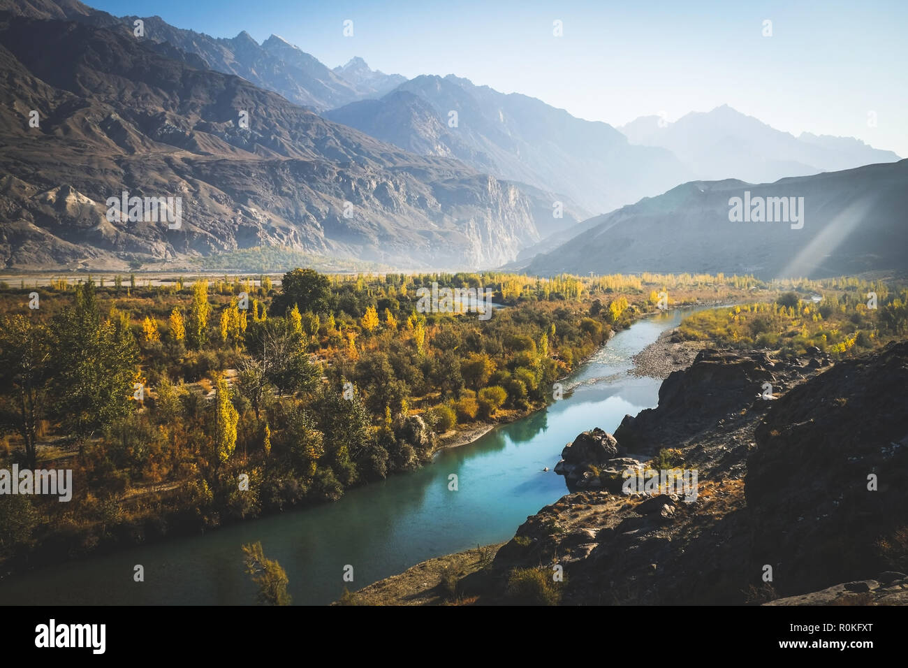 Gakuch in autumn show river flow through colorful forest and surrounded by mountains in karakoram range. Ghizer, Gilgit-Baltistan, Pakistan. - Stock Image