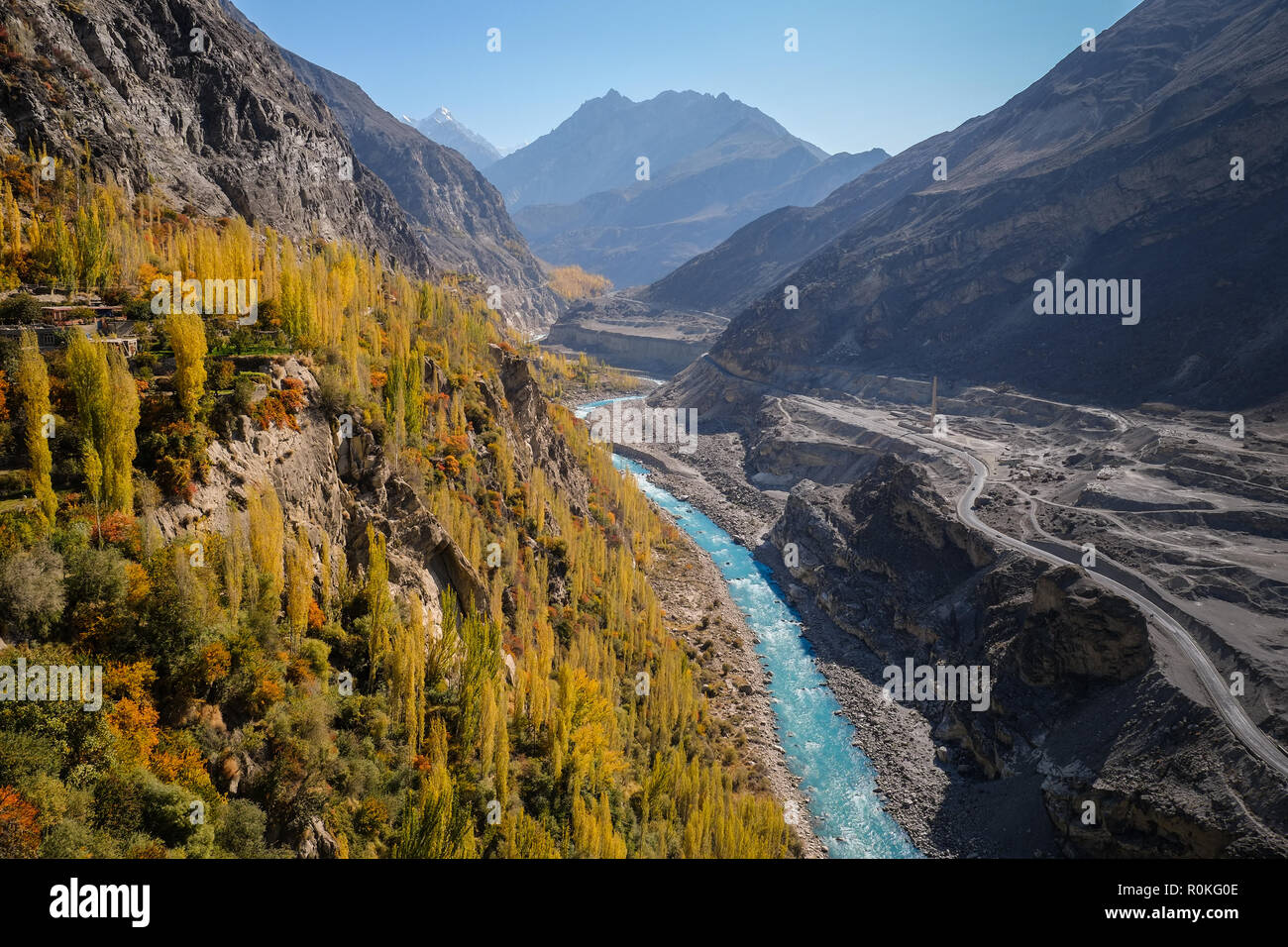 Colorful autumn view of Hunza from Altit fort show blue river flowing along the road through Karakoram mountain range, Gilgit-Baltistan, Pakistan. - Stock Image