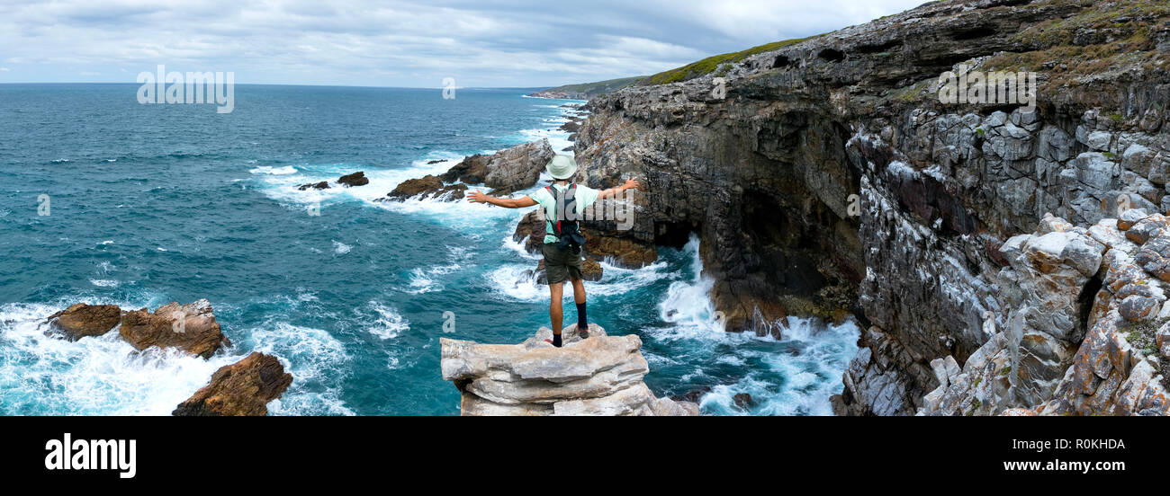 Man standing on the edge of the cliff in the De Hoop Nature Reserve - Stock Image