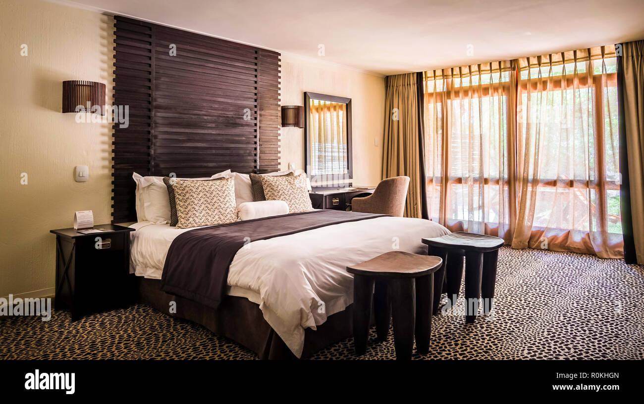 Bedroom in Bakubung Lodge - Stock Image