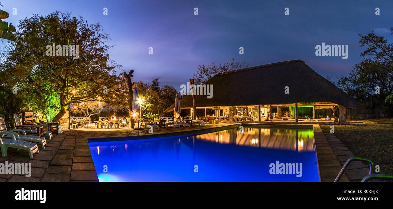 Panoramic evening view of the poolside area of the Timbavati Safari Lodge - Stock Image