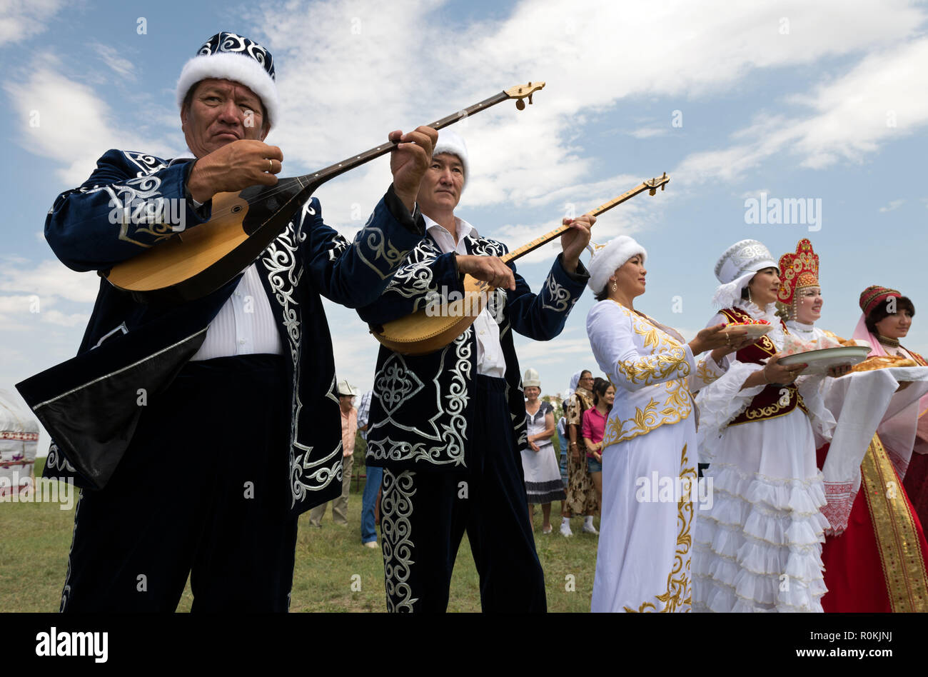 Kazakh national musical group plays dombra in the steppe, Astrakhan, Russia - Stock Image