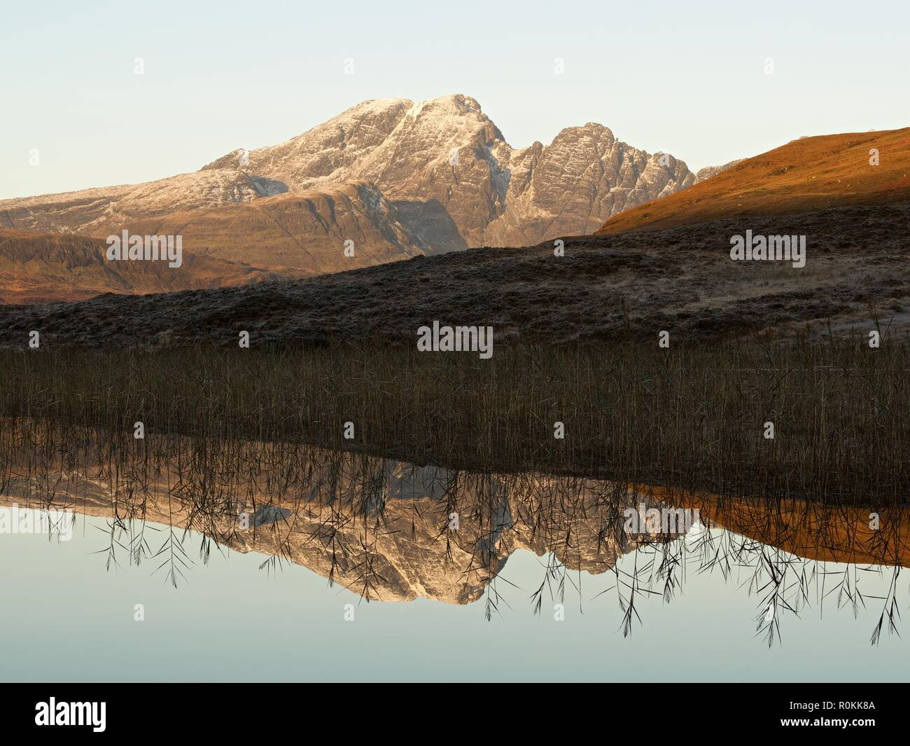 A still sunrise on the Isle of Skye. This was taken from the still waters of Loch Cill Chriosd looking to Blaven and its reflection Stock Photo