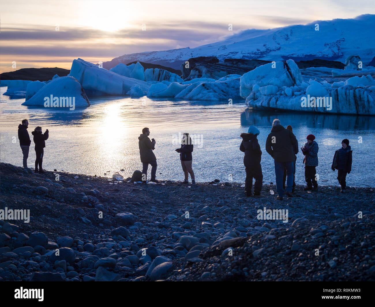 JOKULSARLON, ICELAND-OCTOBER 17, 2018:Tourists at the Jokulsarlon glasier lagoon in Iceland in evening - Stock Image