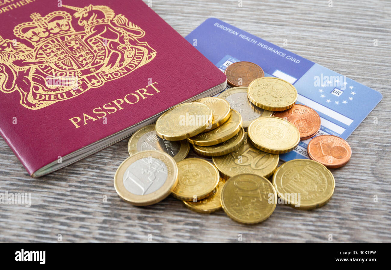 British Passport and a pile of Euros and a European Health Insurance Card. - Stock Image