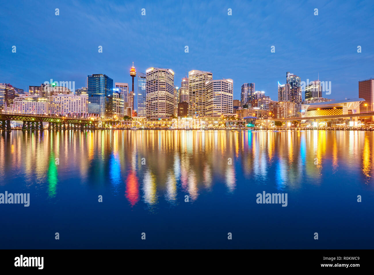 Skyline with skyscrapers in Darling Harbour at dusk, Sydney, New South Wales, Australia - Stock Image