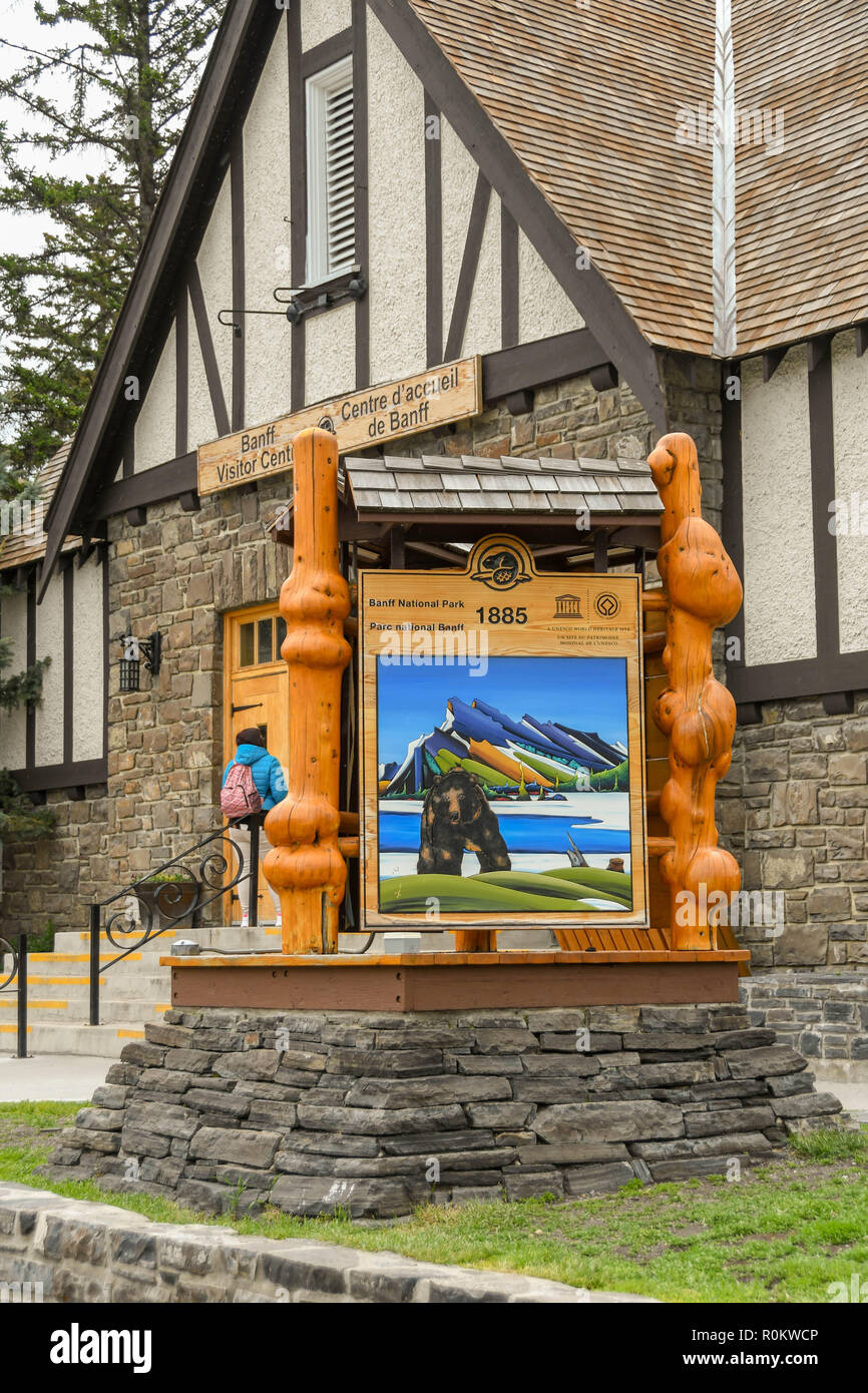 BANFF, AB, CANADA - JUNE 2018: Large sign with wood carvings for Banff National Park outside the Tourist Information Centre in  Banff town centre. - Stock Image
