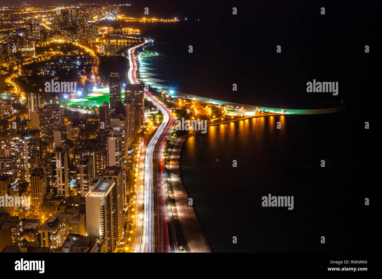 Chicago city areal view during night showing city light in long exposure - Stock Image