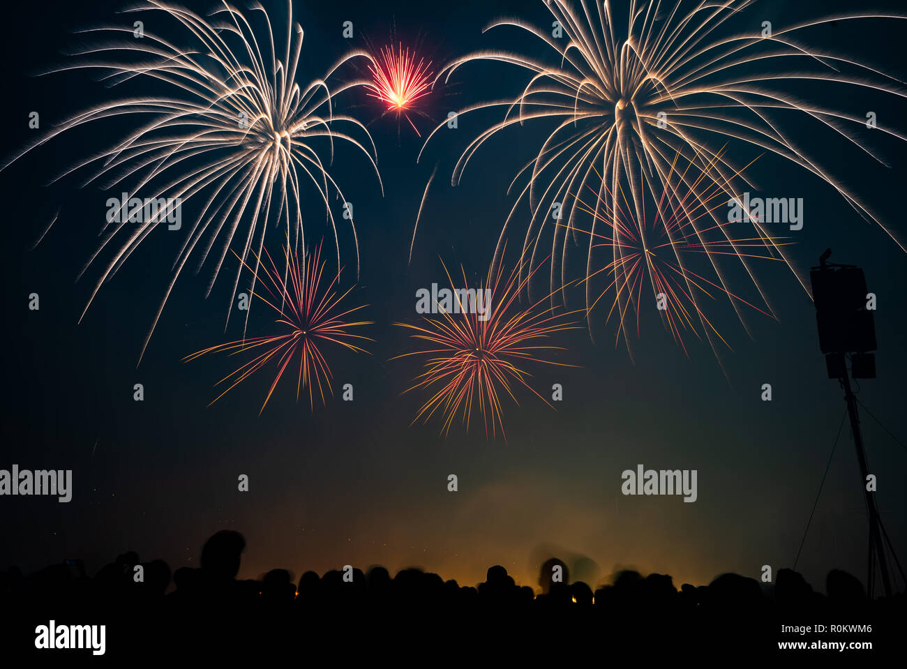 Explosion of firecrackers in the night sky Stock Photo