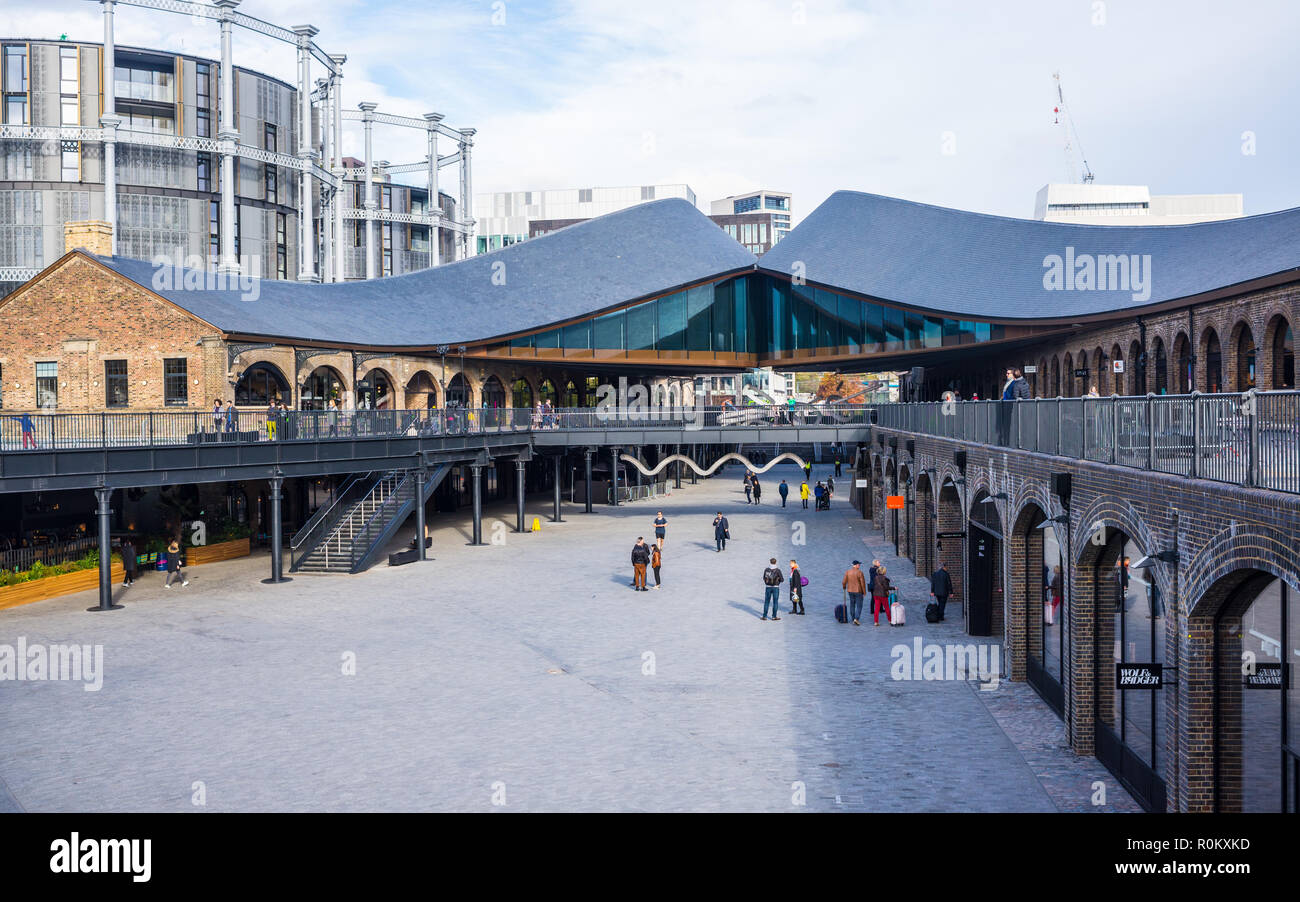 Coal Drops Yard a unique new shopping quarter at King's Cross, London, UK created by Heatherwick Studio by converting two Victorian industrial buildin - Stock Image