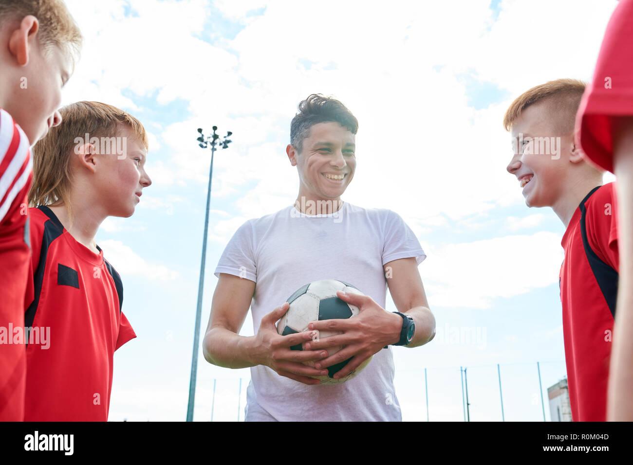3a2c2e4ec Young Football Coach Stock Photo: 224173949 - Alamy