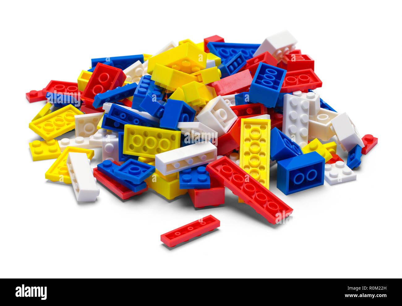 Small Pile of Plastic Toy Blocks Isolated on White. - Stock Image